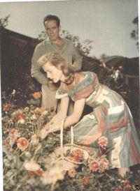 Bogie and Bacall picking flowers